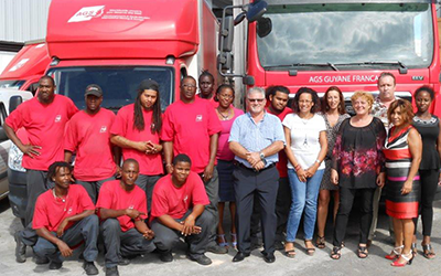 Staff AGS Movers Guiana with red removal trucks