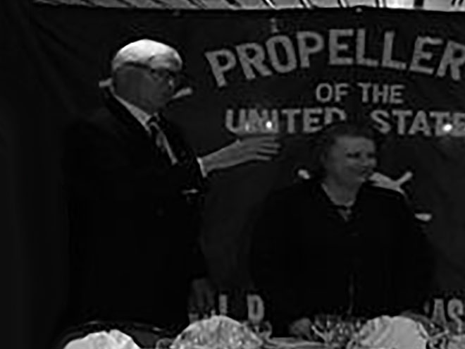 Old picture of a man and a woman in Propeller club of the United States