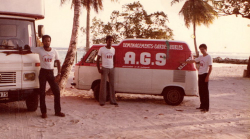 AGS Guadeloupe 3 men posing with movers trucks in the 70s