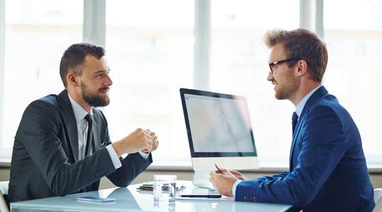2 men having an interview or meeting in an office