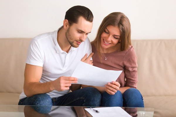 Couple discussing insurance.