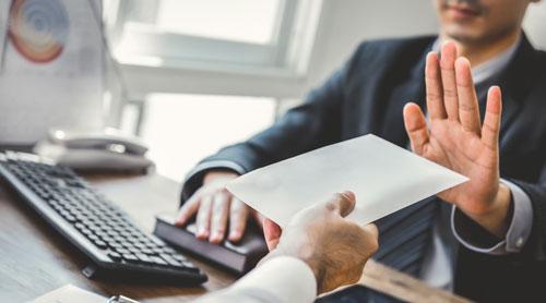 Man declining bribe during an meeting