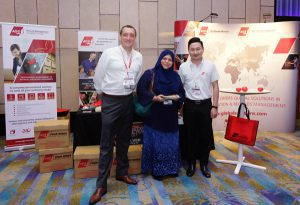 AGS employees at a stand in Malaysia