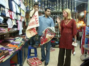 Woman negociating clothes and tissus in a shop