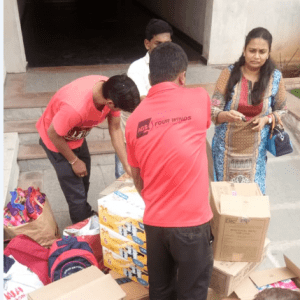 AGS Movers Hyderabad handing out donations to flood victims in Kerala region.