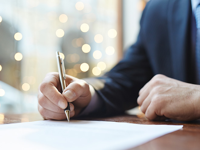 Man signing an agreement