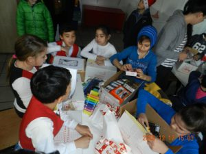 Kids playing with AGS toys and gifts in Romania
