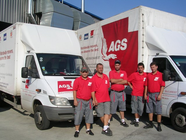 AGS Bucharest team members and truck.