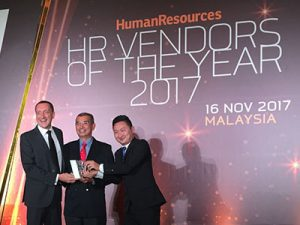 3 men showing their price during HR Vendors of the Year Evening