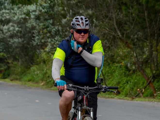 Cyclist fixing his helmet