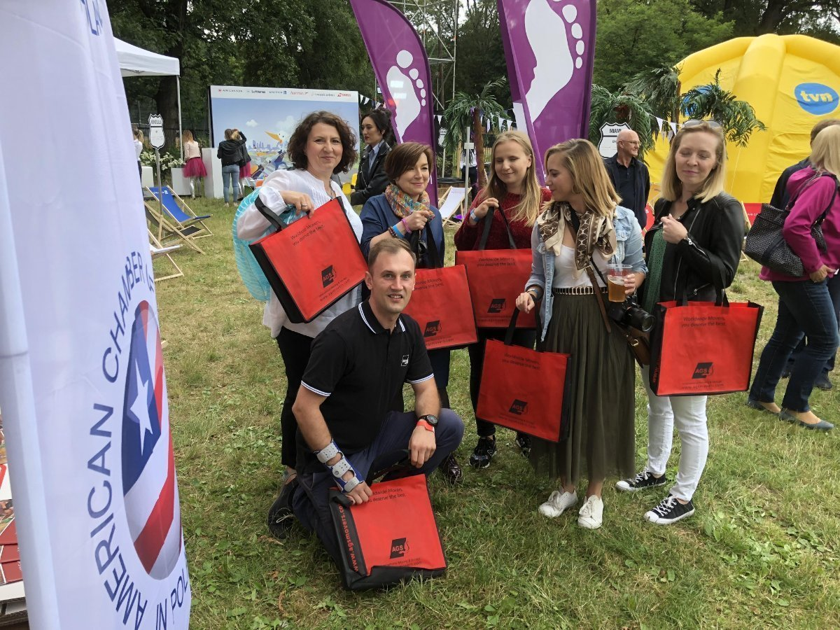 People with AGS Movers bags at the Independance Day Picnic in Poland in 2018.