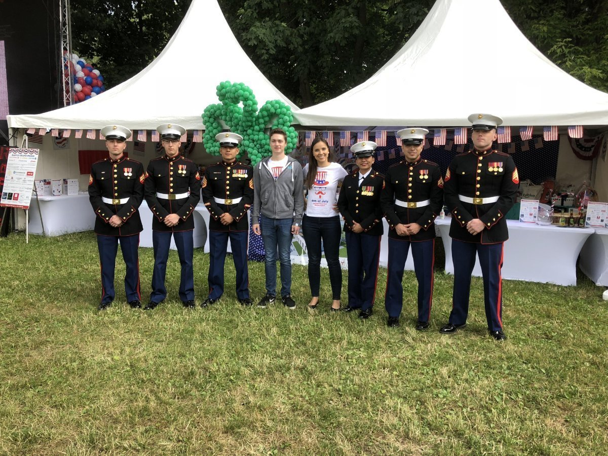 Photo taken of people posing with US Marines.