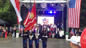 American soldiers walking with flags in Poland