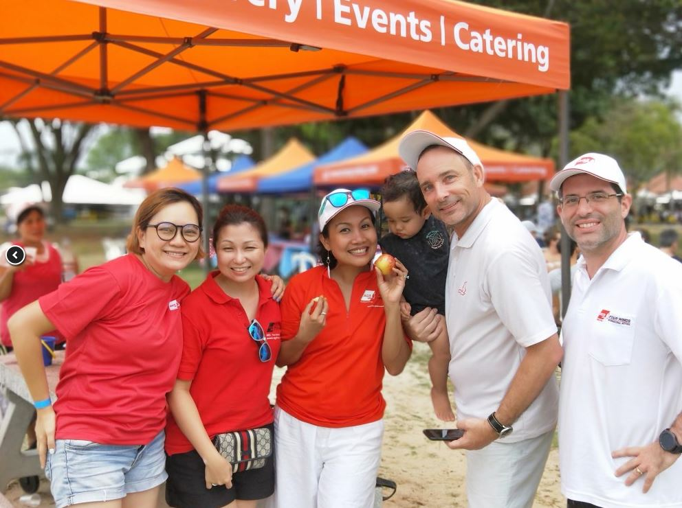 AGS Singapore team members at Pétanque tournament.